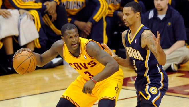 Cleveland Cavaliers guard Dion Waiters (3) dribbles against Indiana Pacers guard George Hill (3) in the first quarter at Quicken Loans Arena.