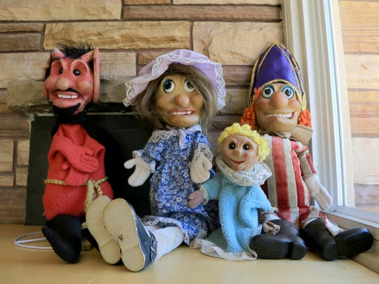 A group of Punch and Judy puppets await A Day of Puppetry