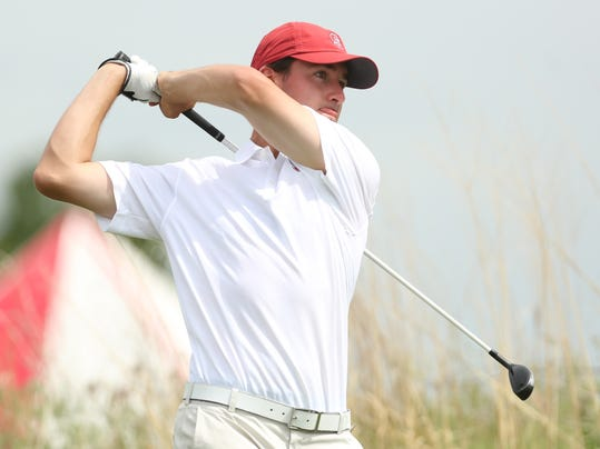 Stanford's Cameron Wilson tees off on the eighth hole during the third round of the NCAA national championship Monday, May 26, 2014, at Prairie Dunes Country Club in Hutchinson, Kan. (AP Photo/The Hutchinson News, Travis Morisse)