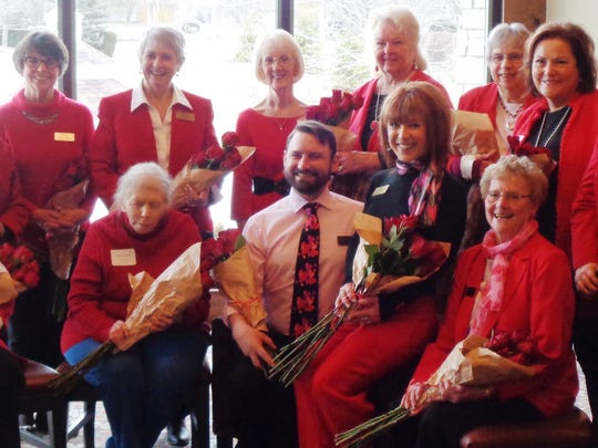 2018 Valentine's Lady Kay Bolin is joined by escort Cory Partin and 11 past Loveland Valentine's Ladies at the Loveland Valentine Program breakfast: Carol Williams, Anne Fowler, Sue Lundy, Linda Cox, Laurie Gordon, Kay Napier, Jan Ranard, Janis Fogle Lu Boike, Pat Furterer and Avery Foster..