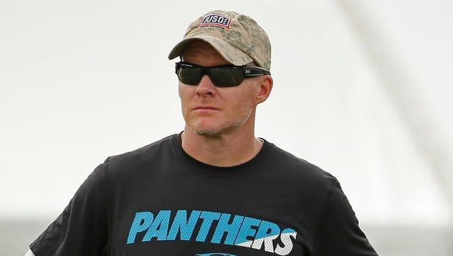 Carolina Panthers defensive coordinator Sean McDermott watches practice Aug. 5, 2015.