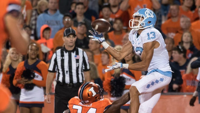 North Carolina receiver Mack Hollins catches a touchdown over Illinois defensive back Darius Mosely during the second half Sept. 10, 2016 at Memorial Stadium in Champaign, Ill.