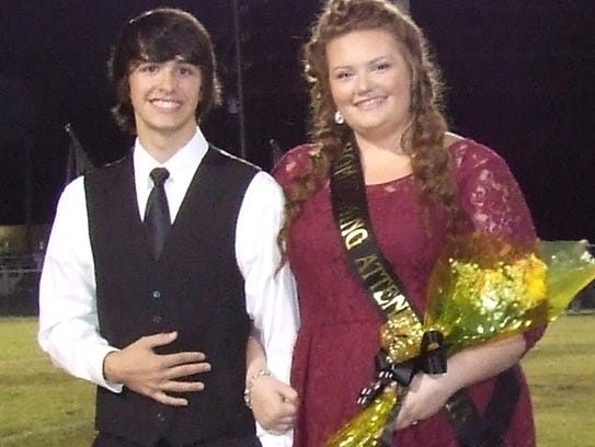 Sophomore Attendant Paige Tidrow, right, is escorted