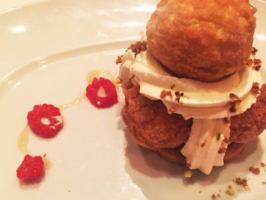 The St. HonorŽé dessert, filled with pistachio cream,