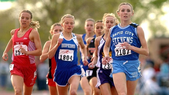 Julie Schwengler of Rapid City Stevens pulls away to win the 2004 girls special event at Howard Wood Field.