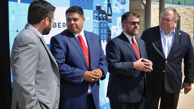 City officials announced Tuesday morning that the ride sharing company Uber would begin operations in Wichita Falls. From left, Chris Miller of Uber, Mayor Stephen Santellana, Henry Florsheim of the Chamber of Commerce and Senator Craig Estes who co-autored a bill in the legislature setting statewide rules for transportation network companies.