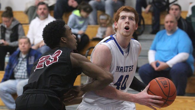 Pearl River's Kevin Degnan drives on Nyack's Barry Battle during a varsity basketball game at Pearl River Jan. 15, 2014. ( Peter Carr / The Journal News )