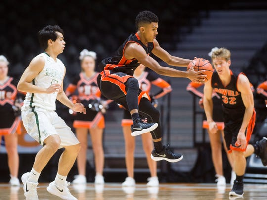 Powell's Riley Bryant jumps for the ball during the