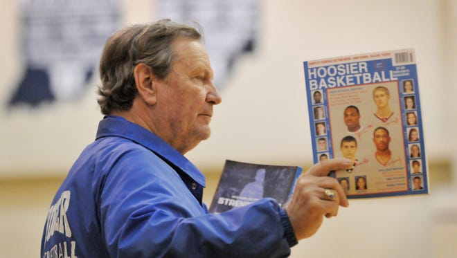 Garry Donna, publisher of Hoosier Basketball Magazine for 46 years, with a copy of the publication in 2010.