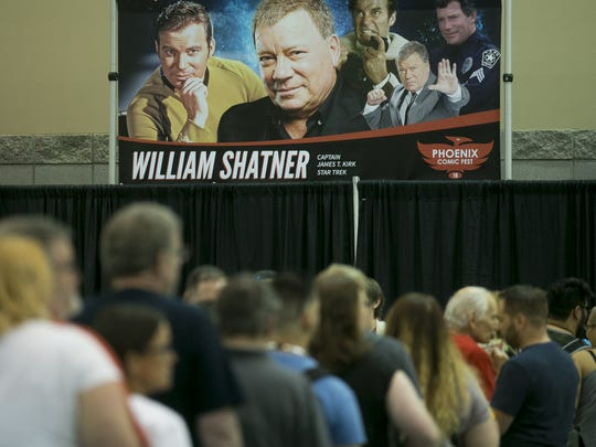 Fans wait in line to get an autograph and meet William Shatner at Phoenix Comic Fest on Friday, May. 25, 2018, in Phoenix, Ariz.