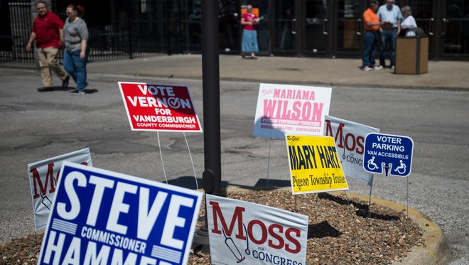 Lawn signs line up outside a voting center at Washington Square Mall on Tuesday, May 8, 2018.