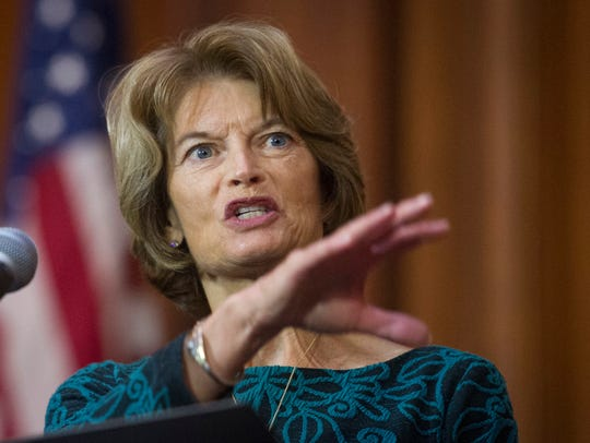 Sen. Lisa Murkowski, R-Ala., speaks Dec. 11, 2018, after an order withdrawing federal protections for countless waterways and wetland was signed at EPA headquarters in Washington, D.C.