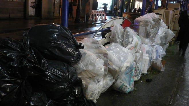 Trash piled on a New York City street.