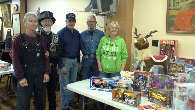 A.B.A.T.E. members shown with some of the toys donated to Christmas Wish from the group's annual toy run are (from left) Gary Grimm, Ray Coahran, Steve Rogers, Pat McLean, and Laura Frasco.
