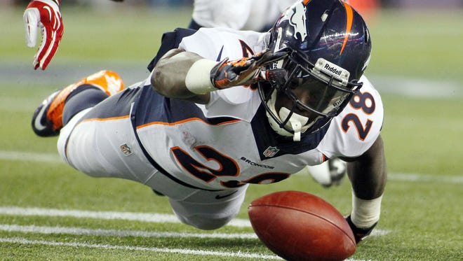 Denver Broncos running back Montee Ball  dives for a fumble against the New England Patriots. The Broncos young backs have had trouble holding onto the ball this season.