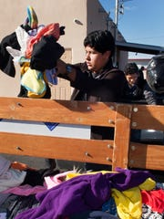 Luis Sanchez, a student at the New America School, sorts clothing donations at the Las Cruces Gospel Rescue Mission Monday morning as part of a service project on Martin Luther King Jr. Day.