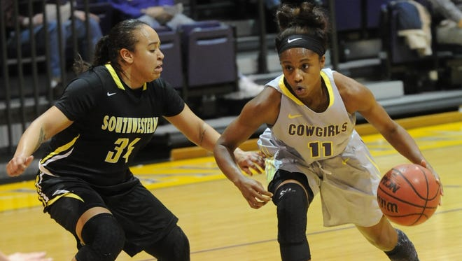 Hardin-Simmons' Jasmine McClellan, right, drives against Southwestern's Brooke Swift during the first half. HSU won the nonconference game 61-57 on Thursday, Dec. 15, 2016 at the Mabee Complex.