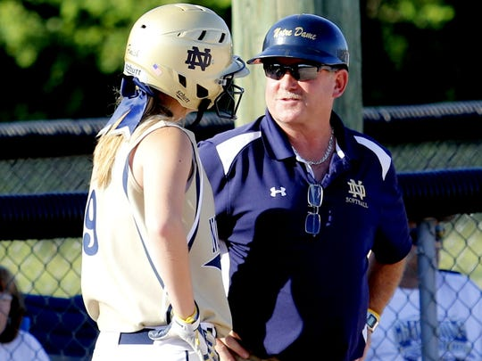 Notre Dame head coach Steve Weber talks with Jordyn Fargo during the Crusaders' 4-0 state quarterfinal victory over Cooperstown in 2016.