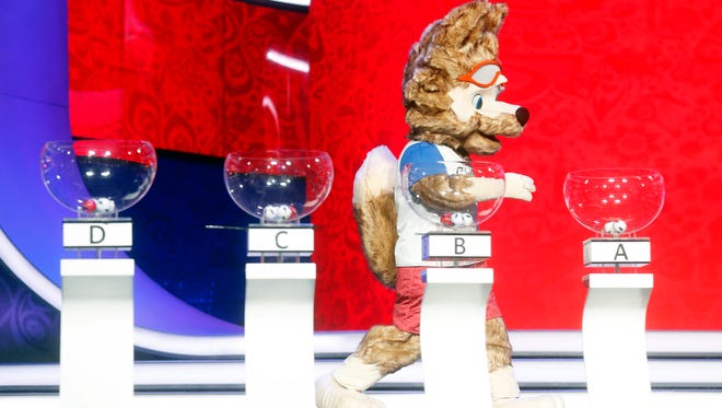 World Cup mascot Zabivaka participates in a rehearsal for Friday's draw in Moscow.