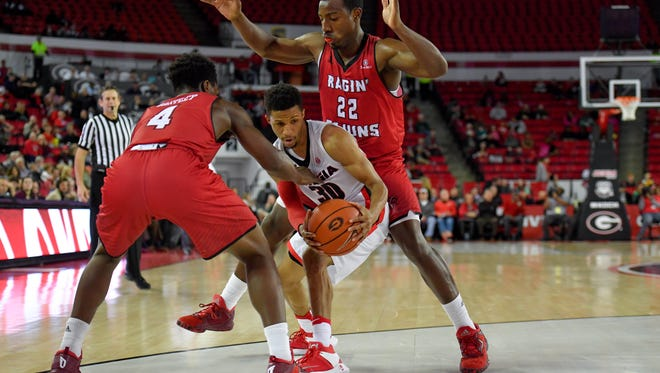 The UL guard tandem of Frank Bartley (4) and Johnathan Stove are hoping to slow down Georgia State's high-flying offense in Thursday's showdown of Sun Belt's top teams.