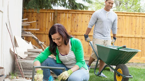 couple doing yardwork together