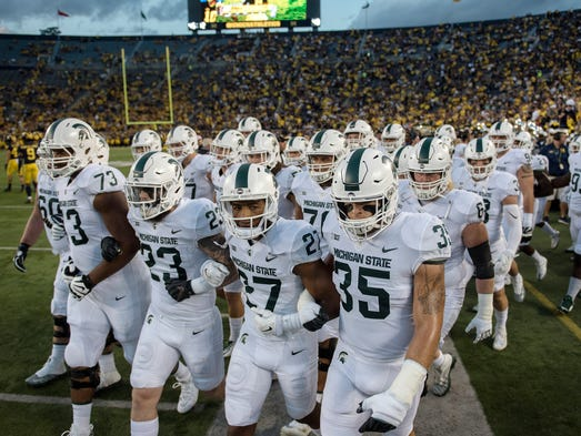 The Michigan State Spartans walk onto the field prior