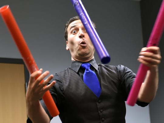 Jacob Weiss does his juggling act during #TouretteTalent Live at the Green Hills Library on Saturday.