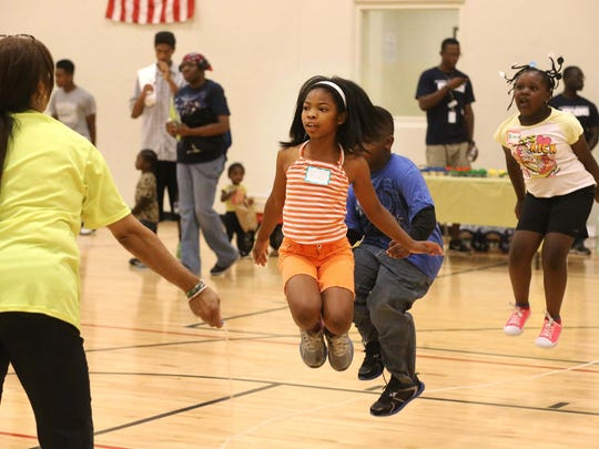 Kiara Williams jumps rope at Community Day on Aug. 16, 2014, at Avondale Meadows YMCA, Indianapolis.