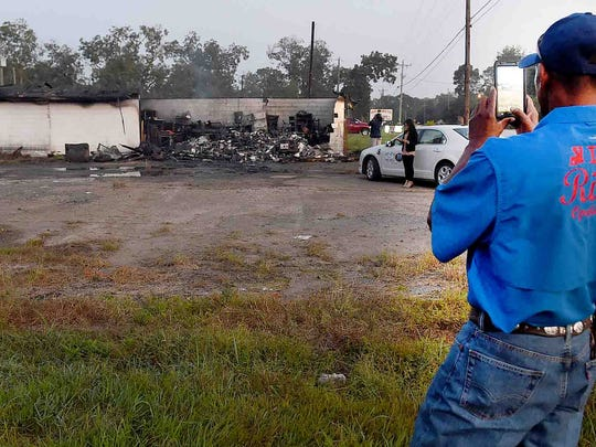 Plaisance residents survey the damage to a building that was destroyed after a vehicle crashed into it early Friday killing the two occupants.
