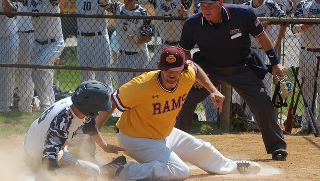 Gloucester Catholic pitcher Eric Grafton tags out Chris Troost at the plate in the fourth inning of Saturday's Joe Hartmann Diamond Classic semifinal.