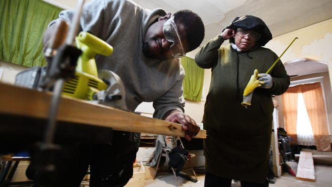 Tiscur Taylor, right, and Allante Burr are two of the 10 participants chosen for Living Trades Academy nine-week program.