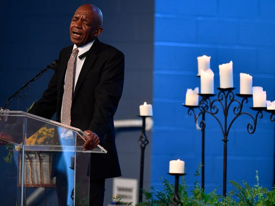 Rev. Enoch Fuzz addresses guests during a prayer vigil at Woodmont Hills Church of Christ Monday, Sept. 25, 2017 in Nashville, Tenn. for victims of the Burnette Chapel Church of Christ mass shooting that happened during Sunday morning services.