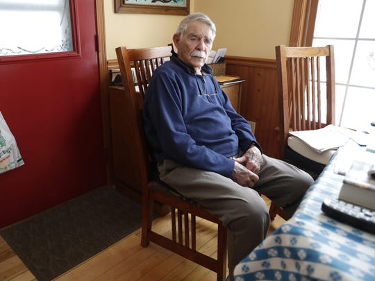 Jack Zito, 96, sits at the kitchen table in his Sister