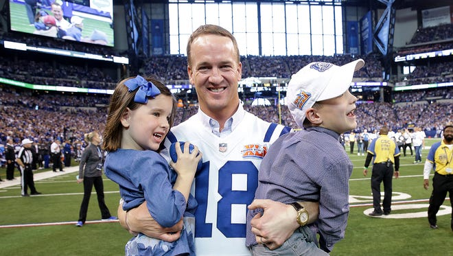 Peyton Manning and his kids Mosley and Marshall during the 10th anniversary reunion of their Super Bowl XLVI win during halftime of the Colts game Sunday, November 20, 206, afternoon at Lucas Oil Stadium