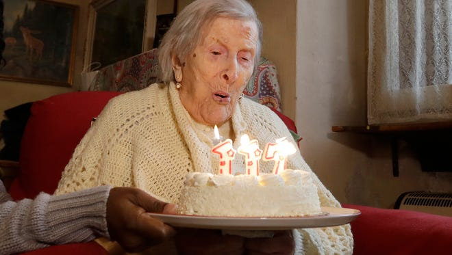 Emma Morano, 117 years old, blows candles in the day of her birthday in Verbania, Italy, Tuesday, Nov. 29, 2016.  At 117 years of age, Emma is now the oldest person in the world and is believed to be the last surviving person in the world who was born in the 1800s.