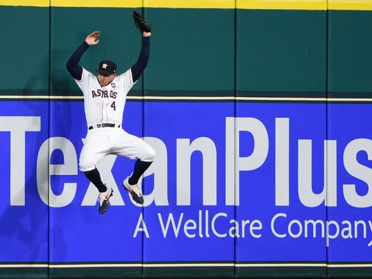 Houston Astros' George Springer catches a long fly ball hit by New York Yankees' Todd Frazier during the seventh inning of Game 6 of baseball's American League Championship Series Friday, Oct. 20, 2017, in Houston.