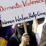 A Pakistani woman holds a placard during a demonstration to protest violence against women, on the International Women's Day in Lahore in 2004.