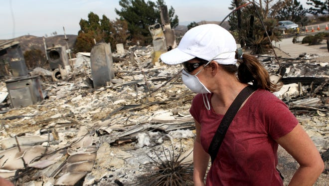 Suzette Privitelli looks at the remains of her home for the first time after her home was destroyed in the Thomas Fire, her and her husband Tom plan to rebuild Sunday December 10, 2017.