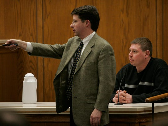 Steven Avery's defense attorney Dean Strang points to a photograph displayed during his questioning of  Brillion volunteer firefighter William Brandes, Jr., the 20th witness in the Avery trial, worked with law enforcement to search vehicles at Avery's Auto Salavage after Teresa Halbach's vehicle was found Nov. 5, 2005. in the courtroom at the Calumet County Courthouse Friday, Feb. 16, 2007, in Chilton, Wis.  Avery is accused, along with his 17-year-old nephew, of killing Teresa Halbach, 25, after she went to the family's rural salvage lot to photograph a minivan they had for sale.  (AP Photo/The Post-Crescent, Kirk Wagner)  POOL