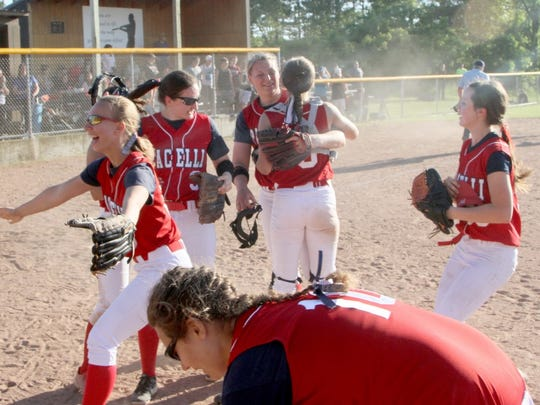 Pacelli players celebrate after knocking off Cochrane-Fountain City in the sectional title game.