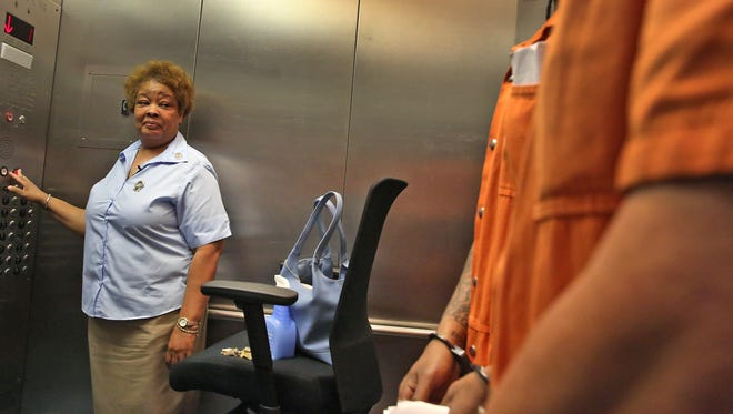 Denise Cummings has been a service elevator operator at the City-County Building since 1981. As part of her job, she transports prisoners, with a Marion County Sheriff's Department escort, to and from court.