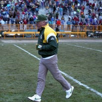 Green Bay Packers coach Lindy Infante runs off the field after a 35-21 loss to the Minnesota Vikings at Lambeau Field on Nov. 17, 1991.
