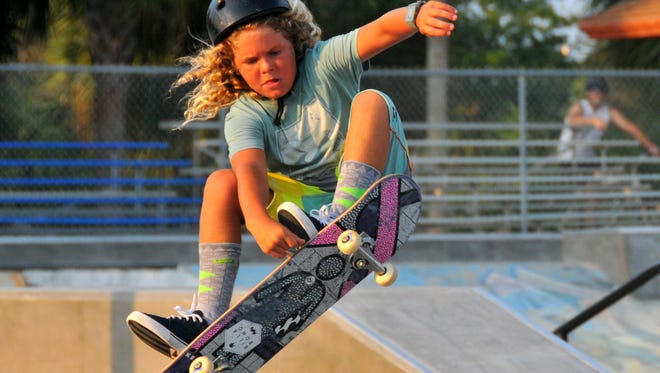 Cash Watters goes up high off the wall Wednesday at the revamped Satellite Beach skatepark.