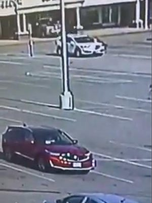 A truck is seen on camera footage backing into the Verizon in the Norton Shopping Center.