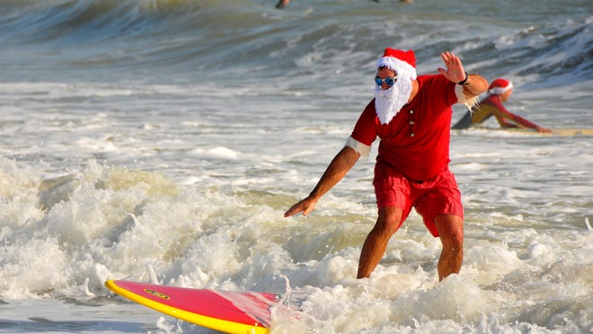According to Cocoa Beach Police Chief Buddy Ayers 4,000 people showed up at Minutemen Causeway to watch almost 300 Surfing Santas take to the water.