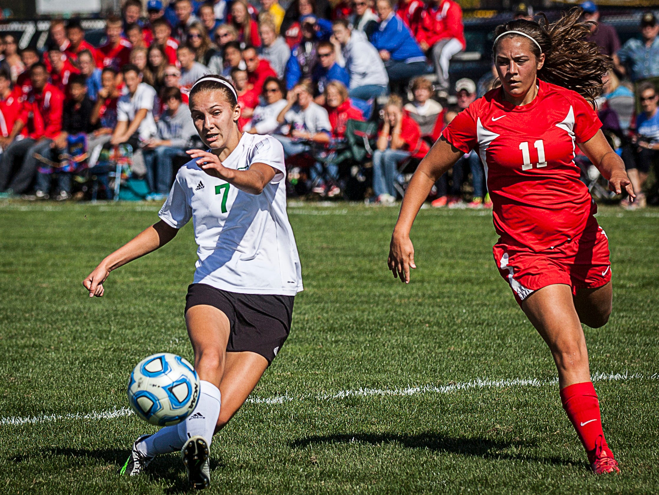 Yorktown's Hannah Rapp takes a shot past Jay County's Emily Muhlenkamp during their game at the Yorktown Sports Park on Saturday, Oct. 10, 2015.