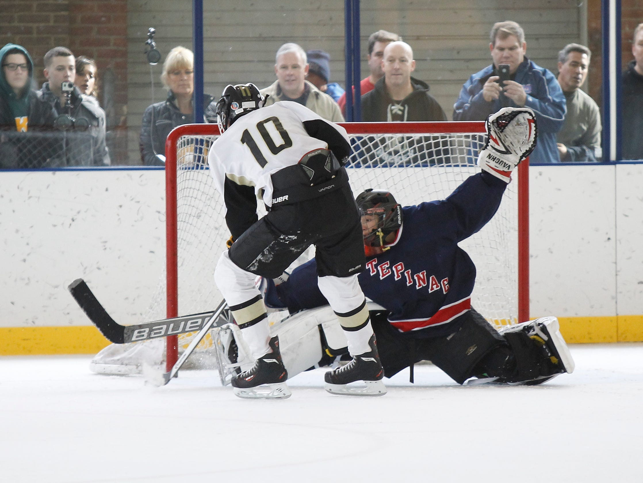 Clarkstown's Harrison Levy (10) scores on a penalty shot against Stepinac goalie Tyler Rosado (1) during a varsity ice hockey game at the 2015 Guy Matthews Thanksgiving Invitational Hockey tournament at Ebersole Ice Rink in White Plains on Friday, Nov. 27, 2015.
