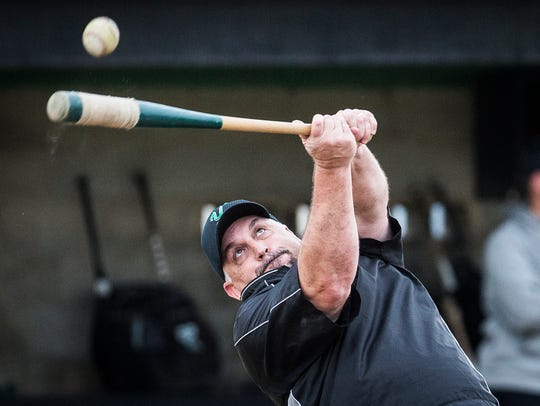 Yorktown baseball coach PJ Fauquher hits for his players