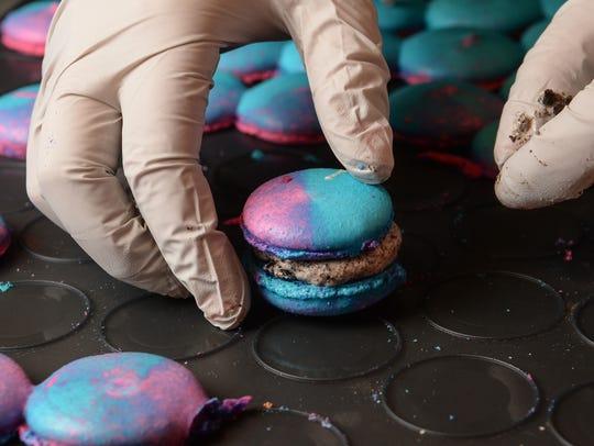 Brandi Lindoe of Clemson Confectioneries picks up a
