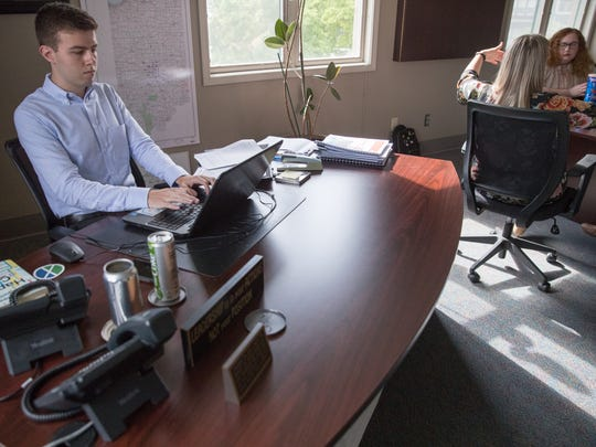 Intern Joe Bergin works at the desk of Fishers Mayor Scott Fadness this summer.